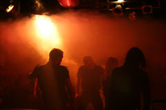 Silhouettes of dancing people. In a small underground club Royalty Free Stock Images