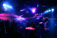 Silhouettes of dancing people. Teenagers dancing in an underground club Stock Photography