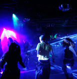 Silhouettes of dancing people. Teenagers dancing in an underground club Stock Photo