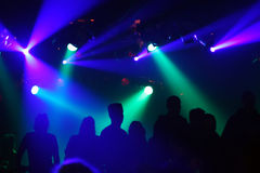Silhouettes of dancing people. Teenagers dancing in an underground club Royalty Free Stock Images