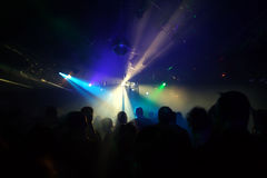 Silhouettes of dancing people. Teenagers dancing in an underground club Stock Image