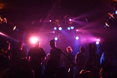 Silhouettes of dancing people. Young teens dancing in an underground club Stock Photo