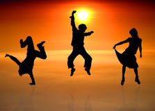 Silhouettes of dancing people Royalty Free Stock Images
