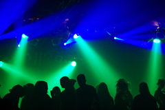 Silhouettes of dancing people. In an underground-club Stock Photography