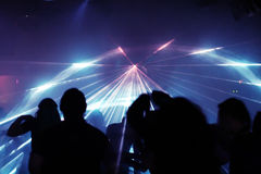 Silhouettes of dancing people. In an underground club royalty free stock photos