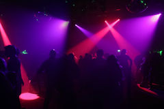 Silhouettes of dancing people. In an underground-club Stock Image