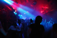 Silhouettes of dancing people. Dancing in an underground-club stock photos