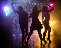 Youth at the party. Silhouettes of Dancing people at a disco, party Royalty Free Stock Photography