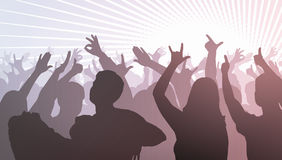 Silhouettes of dancing people in front of bright stage lights Stock Photos