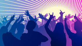 Silhouettes of dancing people in front of bright stage lights. Silhouettes of dancing people in club in front of bright stage lights - disco concept Stock Images