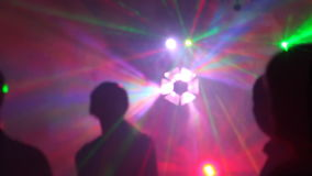 Silhouettes of dancing people in a nightclub stock video footage