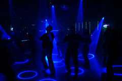 Silhouettes of dancing poeple. In an underground club royalty free stock photo