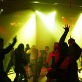Silhouettes of a dancing teenagers. Dancing people in an underground club Royalty Free Stock Photos