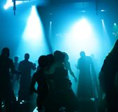 Silhouettes of a dancing teenagers. Dancing people in an underground club Stock Image