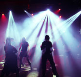 Silhouettes of a dancing teenagers Royalty Free Stock Images