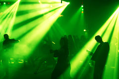 Silhouettes of a dancing teenagers. Dancing people in an underground club Royalty Free Stock Images