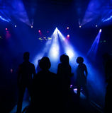 Silhouettes of a dancing teenagers. Dancing people in an underground club Stock Photo