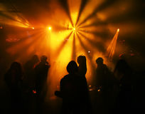 Silhouettes of a dancing teenagers. Dancing people in an underground club Stock Photography