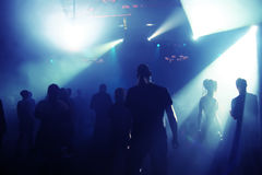 Silhouettes of a dancing teenagers. Dancing people in an underground club Royalty Free Stock Photo