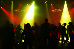 Silhouettes of a dancing teenagers. Dancing people in an underground club Stock Images