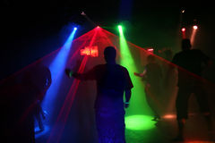 Silhouettes of dancing teenagers. Dancing people in an underground club Stock Photo
