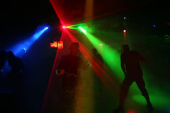 Silhouettes of dancing teenagers. Dancing people in an underground club Royalty Free Stock Photography