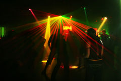 Silhouettes of dancing teenagers. Dancing people in an underground club Stock Photos