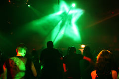 Silhouettes of dancing teenagers. Dancing people in an underground club Stock Image
