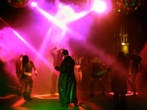 Silhouettes of dancing teenagers. Dancing people in an underground club Stock Photography