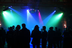 Silhouettes of dancing teenagers. Dancing people in an underground club Royalty Free Stock Photos