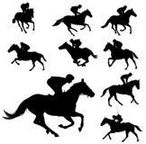 Silhouettes 2 de chevaux et de jockeys d'emballage Photographie stock libre de droits
