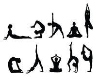 Silhouettes de yoga Photographie stock libre de droits