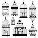 Silhouettes of a decorative vintage bird cages. Set of vector silhouettes on white background. Eight different cages stock illustration