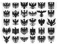 Silhouettes des aigles héraldiques Photo stock