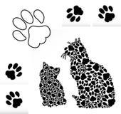Silhouettes des chats des pattes Photographie stock libre de droits