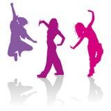 Silhouettes des filles dansant la danse de trouille de jazz Photos stock