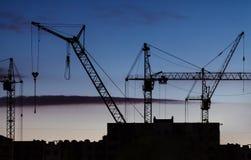 Silhouettes des grues de construction de différents types photo libre de droits