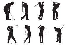 Silhouettes des joueurs du golf photographie stock libre de droits