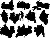 Silhouettes des motobikers Photo stock
