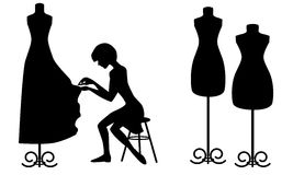 Silhouettes designer and mannequins. On white Stock Image