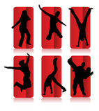 Silhouettes of different people. Silhouettes of party people in a red frame Royalty Free Stock Images