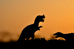 The silhouettes of dinosaurs Stock Photos