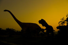 Silhouettes of dinosaurs Stock Image