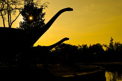Silhouettes of dinosaurs Stock Photo