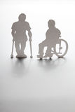 Silhouettes disabled people Royalty Free Stock Photography