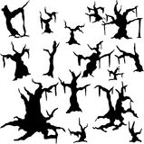 Silhouettes of dried-up trees Royalty Free Stock Images
