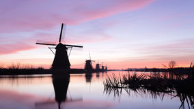 Silhouettes of Dutch Windmills at Kinderdijk Royalty Free Stock Images