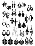 Silhouettes of earrings. Set of black silhouettes of female earrings isolated on white background Royalty Free Stock Images