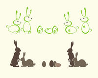 Silhouettes of Easter bunnies. Set of silhouettes of Easter bunnies and eggs painted in green and brown tones Royalty Free Stock Photo
