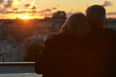 Silhouettes of elderly couple Stock Images